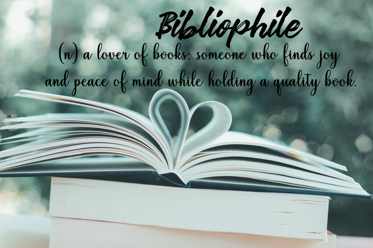 Bibliophile wording with meaning on books background with heart shape in the garden cafe - Retro Vintage filter